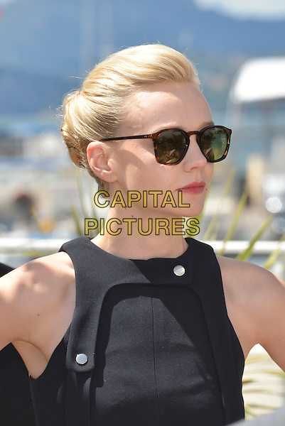 Carey Mulligan.'Inside Llewyn Davis' film photocall at the 66th  Cannes Film Festival, Cannes, France, 19th May 2013..portrait headshot hair up black sleeveless sunglasses tortoiseshell brown  side .CAP/PL.©Phil Loftus/Capital Pictures.