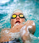 Pepperwood's Dvis Handley competes in the 50 yard back race during the 53rd annual Country Club Swimming Championships on Tuesday, Aug. 7, 2012, in Kearns, Utah. (© 2012 Douglas C. Pizac)
