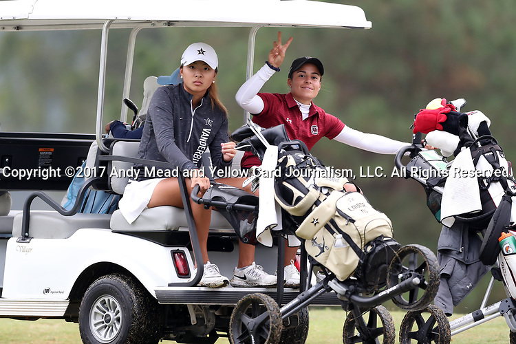CHAPEL HILL, NC - OCTOBER 15: Vanderbilt's Louise Yu (left) and South Carolina's Isidora Nilsson (right) are shuttled to the 1st tee. The third and final round of the Ruth's Chris Tar Heel Invitational Women's Golf Tournament was held on October 15, 2017, at the UNC Finley Golf Course in Chapel Hill, NC.
