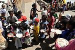 """MADAGASCAR Antananarivo, catholic priest Per Pedro Opeka has build Akamasoa a social community project with housing schemes, health units and schools for the poorest of Tana, free food distribution for street children / MADAGASKAR Pater Pedro Opeka hat die Gemeinde Akamasoa , auf madagassisch """"gute Freunde"""" , mit Muellsammlern, Bettlern und Sozialschwachen auf einem Huegel bei Antananarivo erbaut, Teil des Projektes sind Hausbau, Schulen, Krankenhaeuser und Beschaeftigung, kostenlose Essensverteilung an Strassenkinder"""