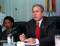 Sept. 17, 2001, Washington, DC, United States<br /> <br /> President George W. Bush addresses the media at the Pentagon on Sept. 17, 2001, following a meeting with his national security team and leaders of the National Guard and Reserve forces. Seated at the left is National Security Advisor Condoleezza Rice.