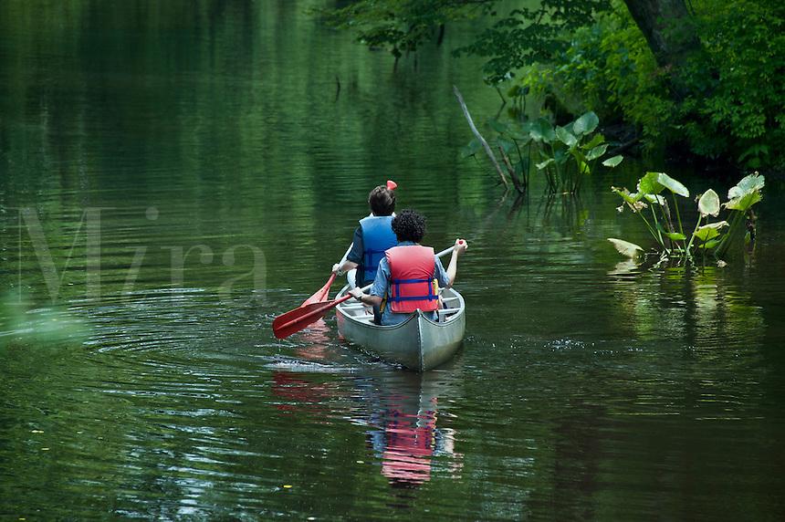 Teens canoeing, New Jersey, USA