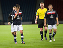 Dundee players are dejected at the end of the game .....