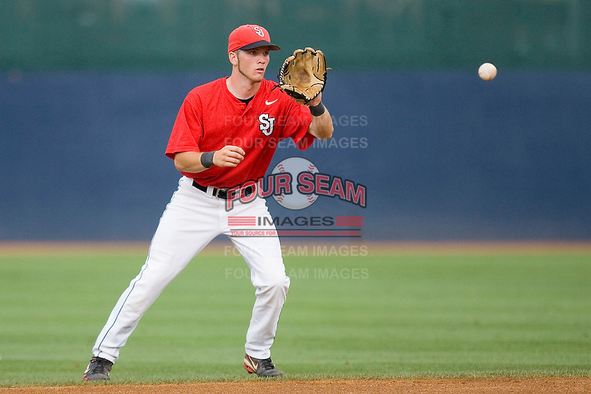 Second baseman Matt Wessinger #0 of the St. John's Red Storm fields a ground ball against the Virginia Cavaliers at the Charlottesville Regional of the 2010 College World Series at Davenport Field on June 6, 2010, in Charlottesville, Virginia.  The Red Storm defeated the Cavaliers 6-5.   Photo by Brian Westerholt / Four Seam Images