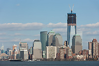 The rising One World Trade Center (Freedom Tower) and Manhattan skyline in New York City as viewed from New York Harbor.
