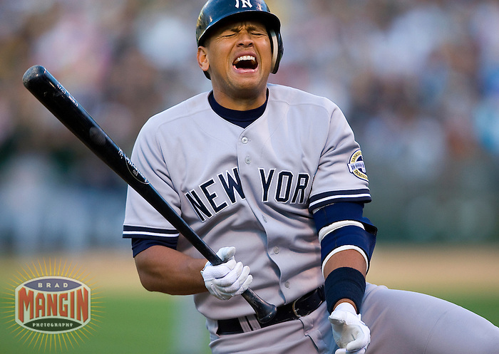 OAKLAND, CA - AUGUST 18:  Alex Rodriguez #13 of the New York Yankees grimaces after being hit by a pitch during first inning action against the Oakland Athletics during the game at the Oakland-Alameda County Coliseum on August 18, 2009 in Oakland, California. Photo by Brad Mangin