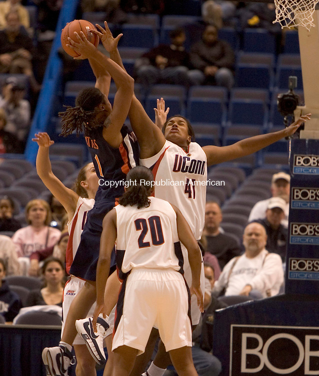 HARTFORD --05 DECEMBER 2007-120507JS03-UConn's Kaili McLaren tries to block a shot by Virginia's Lyndra Little<br /> during their game Monday at the Hartford Civic Center.<br />  Jim Shannon/Republican-American