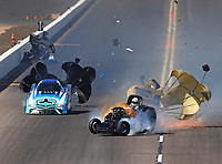 Feb 25, 2018; Chandler, AZ, USA; NHRA funny car driver John Force (right) crosses the track in front of Jonnie Lindberg after suffering an explosion prior to crashing during the Arizona Nationals at Wild Horse Pass Motorsports Park. Mandatory Credit: Mark J. Rebilas-USA TODAY Sports