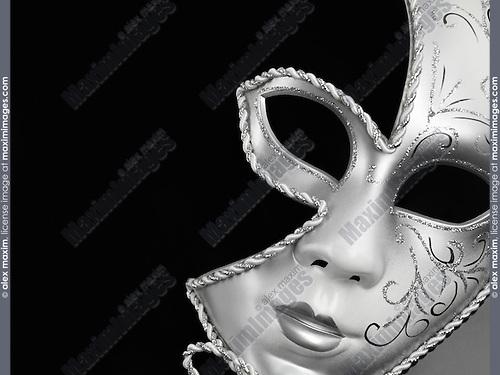 Beautiful silver Venetian mask isolated on black background