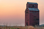 Abandoned grain elevator at sunset in Neidpath, Saskatchewan.