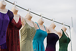 Old Westbury, New York, U.S. - August 23, 2014 - Colorful summer dresses hang displayed over the Moon Mountain booth tent at the 54th Annual Long Island Scottish Festival and Highland Games, co-hosted by L. I. Scottish Clan MacDuff, at Old Westbury Gardens, on Long Island's Gold Coast.