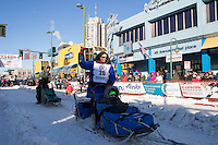 Karin Hendrickson and team leave the ceremonial start line with an Iditarider and handler at 4th Avenue and D street in downtown Anchorage, Alaska on Saturday March 4th during the 2017 Iditarod race. Photo © 2017 by Brendan Smith/SchultzPhoto.com.