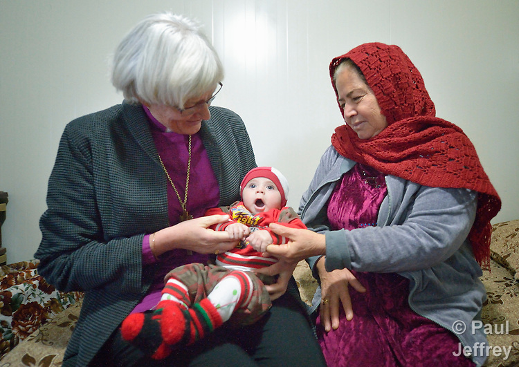 Archbishop Antje Jackelen of the Church of Sweden (left) talks with Azra Said and her baby Jaynar in the Ashti camp for displaced persons in Ankawa, in the Kurdistan region of northern Iraq. Said and her family, who are Christians, were displaced from their home in Qaraqosh in 2014 by the Islamic State group. Jackelen came to Iraq as part of an international ecumenical delegation organized by the World Council of Churches.