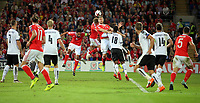 Ashley Williams, Aaron Ramsey and Sam Vokes of Wales (C) jump for a header during the FIFA World Cup Qualifier Group D match between Wales and Austria at The Cardiff City Stadium, Cardiff, Wales, UK. Saturday 02 September 2017