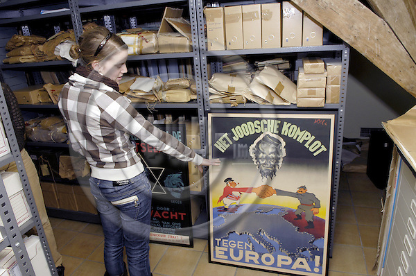 Mechelen-Belgium - 19 March 2008---Nele KRÖGER (Kroeger, Kroger), German volunteer with Aktion Sühnezeichen Friedensdienste e.V. (Action Reconciliation Service for Peace), serving at the Jewish Museum of Deportation and Resistance; here, in the archive of the museum---Photo: Horst Wagner / eup-images