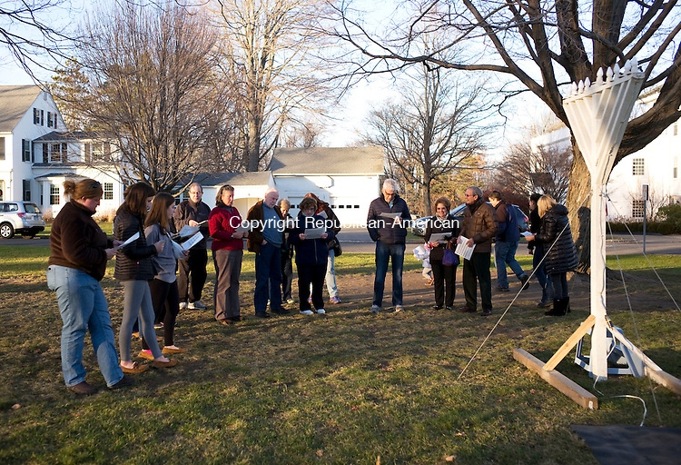 Middlebury, CT- 06 December 2015-120615CM15-  A group of people from the Middlebury community gather on the green to celebration the start of Hanukkah on Sunday. The lighting of the Menorah marked the start of the Jewish holiday, which began on the evening of December 6th.   Christopher Massa Republican-American