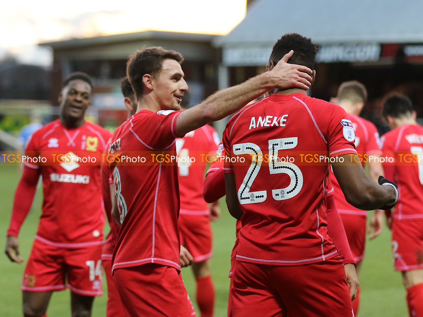 Darren Potter congratulates Chuks Aneke after scoring MK Dons third goal during Peterborough United vs MK Dons, Sky Bet EFL League 1 Football at London Road on 28th January 2017