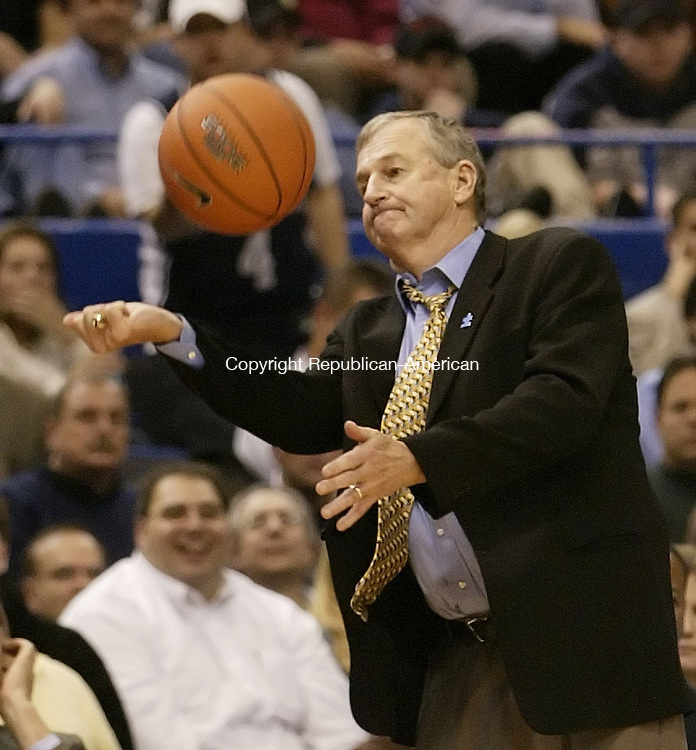 HARTFORD, CT, 01/17/08- 011708BZ15- UConn head coach Jim Calhoun hits the ball up in the air in frustration after Doug Wiggins (3) lost the ball  out of bounds during their game against Providence at the XL Center in Hartford Thursday night.<br /> Jamison C. Bazinet Republican-American