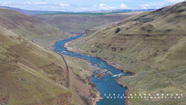 The lower Deschutes Canyon as it cuts through the wheat fields and wind turbines of the Columbia Plateau. The Deschutes River Trail is on the right side of the river.