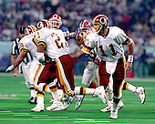 Washington Redskins quarterback Mark Rypien hand the ball off to running back Earnest Byner (21) during Super Bowl XXVI against the Buffalo Bills in Minneapolis, Minnesota on January 26, 1992.  The Redskins won the game and the World Championship 37 - 24.<br /> Credit: Arnie Sachs / CNP