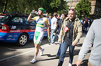 Simon Gerrans (AUS/Orica-GreenEDGE) walking back to the team bus after he crashed heavily in the sprint (taken down by Mark Cavendish)<br /> <br /> 2014 Tour de France<br /> stage 1: Leeds - Harrogate (190.5km)