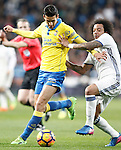 Real Madrid's Marcelo Vieira (r) and UD Las Palmas' Vicente Gomez during La Liga match. March 1,2017. (ALTERPHOTOS/Acero)
