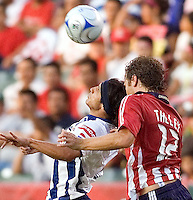 Chivas USA defender Carey Talley (12) goes up against Pachuca midfielder Damien Alvarez (7) for a ball. Pachuca CF defeated the Chivas USA 2-1 during the 1st round of the 2008 SuperLiga at Home Depot Center stadium, in Carson, California on Sunday, July 13, 2008.