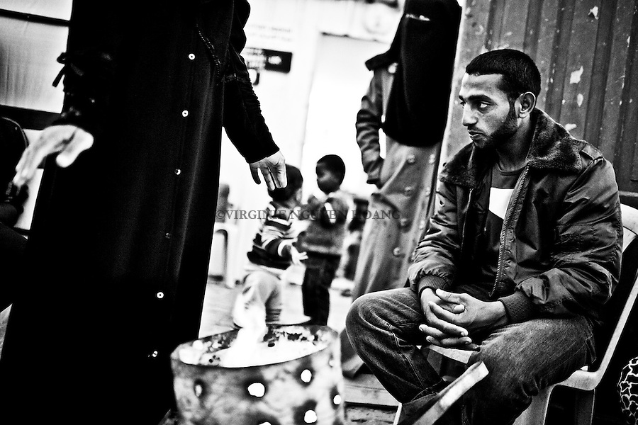 Gaza: Khuzaa: Islam, fils de Feda, devant la maison temporaire de sa m&egrave;re en fin de journ&eacute;e. Islam est un ouvrier sans emploi. Avec sa m&egrave;re et ses soeurs, ils ont tout perdu lors de la guerre de l'ete 2014. Ils survivent gr&acirc;ce a des dons d'ONG et de leur famille. <br /> <br /> Gaza: Khuzaa: Islam, Feda's son, in front of the temporary home of his mother in the late afternoon. Islam is an unemployed worker. With his mother and sisters, they have lost everything in the war of summer 2014. They survive thanks to donations from NGOs and their family.