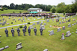 KSP honor guard paid tribute with a 21 gun salute.  Kentucky State Trooper Eric Keith Chrisman was laid to rest Monday June 29, 2015 in Lawrenceburg, Ky.  He died in the the line of duty June 23, 2015.  Police officers and Fire fighters from across Kentucky and the Nation came to pay respects to his family.  Photo by Mark Mahan