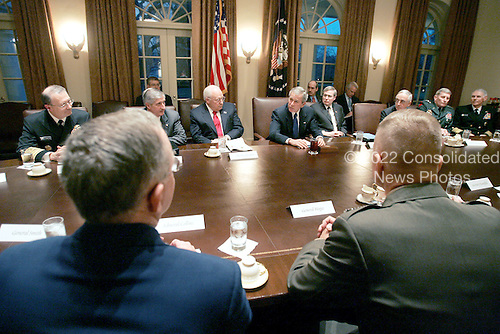 Washington, D.C. - January 9, 2006 -- United States President George W. Bush and Vice President Dick Cheney attend a meeting with the members of the Joint Chiefs of Staff and Combatant Commanders in the Cabinet Room, Monday January 9, 2006, at the White House.  The Combatant Commanders are part of the Unified Command Plan responsible for the geographic military operations around the world..Credit: David Bohrer - White House via CNP.