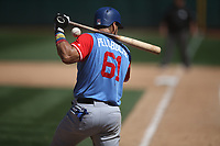 "OAKLAND, CA - AUGUST 26:  Robinson Chirinos #61 of the Texas Rangers hits a foul ball against the Oakland Athletics during the game at the Oakland Coliseum on Saturday, August 26, 2017 in Oakland, California. Note: both teams are wearing special colorful uniforms for ""Players Weekend"" that also include nicknames on the backs of their jerseys. (Photo by Brad Mangin)"