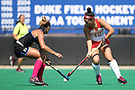 02 October 2016: Boston's Sara Martineau (12) and Duke's Morgan Bitting (left). The Duke University Blue Devils hosted the Boston University Terriers at Jack Katz Stadium in Durham, North Carolina in a 2016 NCAA Division I Field Hockey match. Duke won the game 2-1.