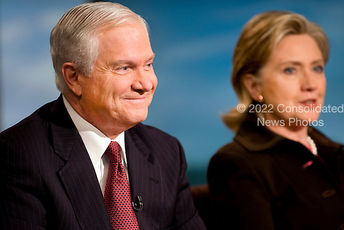 Washington, DC - December 6, 2009 -- United States Secretary of Defense Robert M. Gates and Secretary of State Hillary Clinton talk with NBC's Meet the Press host David Gregory in Washington, D.C., Sunday, December 6, 2009.  This was the first time that the two cabinet members had appeared on Sunday morning talk shows together.  .Mandatory Credit: Cherie Cullen - DoD via CNP