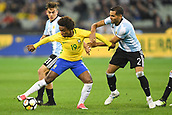 June 9th 2017, Melbourne Cricket Ground, Melbourne, Australia; International Football Friendly; Brazil versus Argentina; Willian Silva of Brazil fights off Paul Exequiel Dybala (L) of Argentina and Gabriel Mercado of Argentina (R)