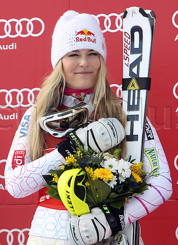27.01.2012 St Moritz, Switzerland. The AUDI FIS Alpine Skiing World Cup Super Combination race, one run of downhill and one run of slalom held on the Engiadina course.  Award Ceremony Picture shows Lindsey Vonn USA