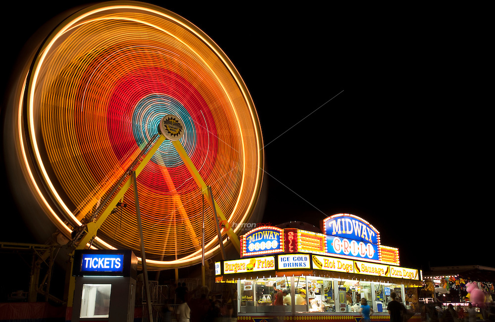 Abstract of amusement park ride with motion blur. Photographed at night with slow shutter speed.