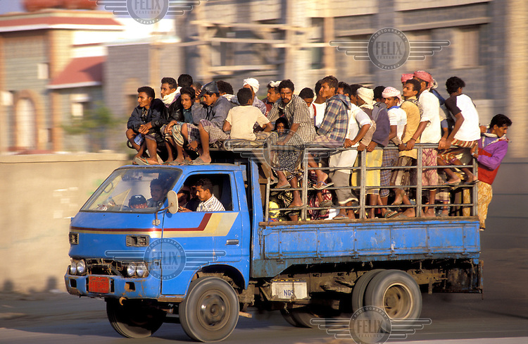 © Chris Stowers / Panos Pictures..YEMEN..Men and boys crowded on to the back of a truck.