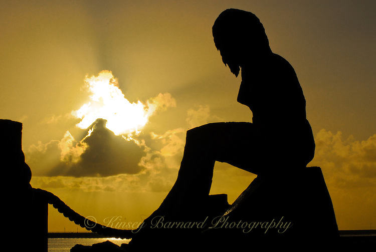 Silhouette of a mermaid at sunset at Crescent City Harbor, California
