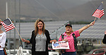 Mustang Sallie, left, and Robin Gouty, joined about 400 supporters who rallied outside a private memorial service in Carson City, Nev., Sunday afternoon, Sept. 11, 2011, for the three Nevada National Guard members killed earlier this week by a gunman in an IHOP restaurant. (AP Photo/Cathleen Allison)