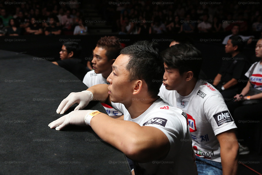 Coaches for Dwae Hwan Kim, Kamma Bantamweight Champion urge him on from the ringside <br />