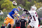 Los Angeles, CA 04/02/10 - Aaron Messmer (UCSB #9) and Michael Hanover (LMU #25) in action during the UCSB-LMU MCLA SLC conference lacrosse game at Loyola Marymount University.