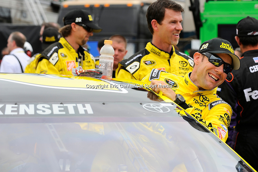 July 14, 2013 - Loudon, New Hampshire U.S. - Sprint Cup Series driver Matt Kenseth (20) climbs into his car for the start of the NASCAR Sprint Cup Series Camping World RV Sales 301 held at the New Hampshire Motor Speedway in Loudon, New Hampshire.   Eric Canha/CSM