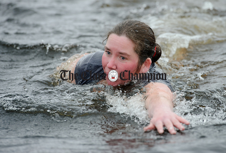 Frances Mc Geehan in action during the annual Christmas day swim at Gortglas  Lake, Kildysart in aid of the West Clare Mini Marathon Cancer fund. Photograph by John Kelly.
