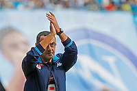 Napoli's coach  Maurizio Sarri greets the supporter  before  the Italian Serie A soccer match between SSC Napoli and AC Fiorentina  at San Paolo stadium in Naples,October 18, 2015