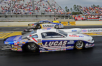 Mar. 10, 2012; Gainesville, FL, USA; NHRA pro stock driver Larry Morgan (near lane) races alongside Rodger Brogdon during qualifying for the Gatornationals at Auto Plus Raceway at Gainesville. Mandatory Credit: Mark J. Rebilas-