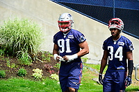 June 7, 2017: New England Patriots defensive end Deatrich Wise (91) and defensive back David Jones (34) walk to practice at the New England Patriots mini camp held on the practice field at Gillette Stadium, in Foxborough, Massachusetts. Eric Canha/CSM