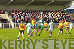 Ballyduff's Aiden Boyle is 1st to the ball over Emmet's Sean McCarthy(no 9)