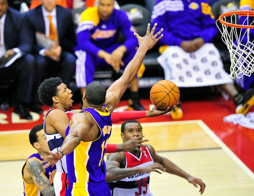 Nick Young of the Wizards goes up for layup against the Lakers' defense. Washington defeated Los Angeles 106-101 at the Verizon Center in Washington, D.C. on Wednesday, March 7, 2012. Alan P. Santos/DC Sports Box