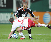 DC United midfielder Fred (27) goes against New York Red Bulls midfielder Teemu Tainio (2)     The New York Red Bulls defeated DC United 4-0, at RFK Stadium, Saturday April 21, 2011.