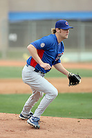 Andrew Cashner #48 of the Chicago Cubs participates in pitchers fielding practice during spring training workouts at the Cubs complex on February 19, 2011  in Mesa, Arizona. .Photo by Bill Mitchell / Four Seam Images.